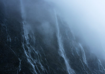 Waterfalls emerging from mist