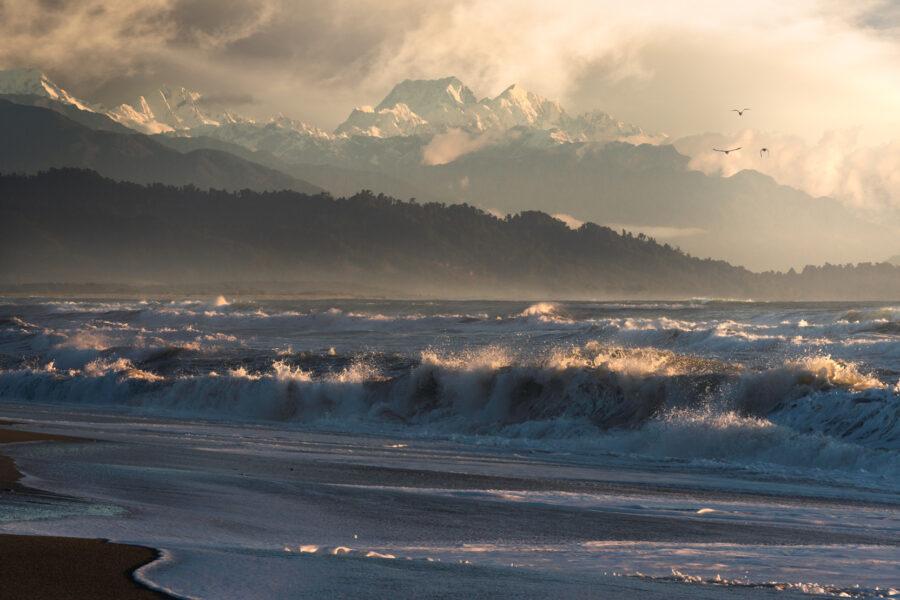 Aoraki/Mt Cook and Mt Tasman, West Coast beach, New Zealand. Photography by William Patino.