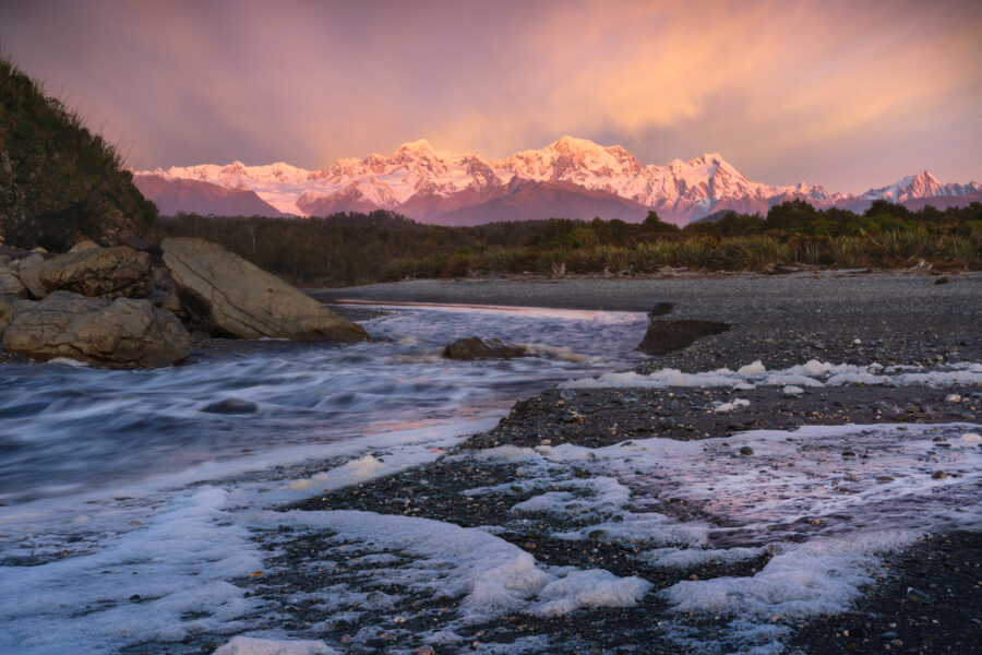Beach and Southern Alps sunset, New Zealand. Photography by William Patino.