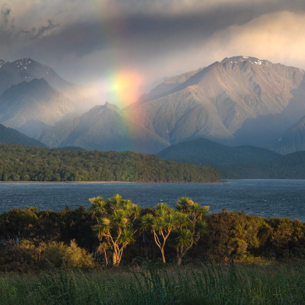 Lake Te Anau sunrise rainbow, Copyright William Patino