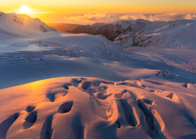 Sunset across an ice-field and glaciers in New Zealand