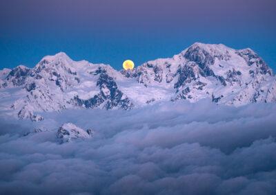 Full moon rise behind Mount Cook and Tasman