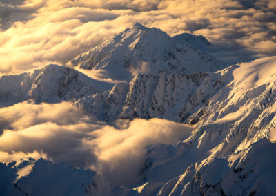 Snow covered mountains and cloud, New Zealand